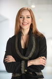 Donna di affari Smiling Indoors Fotografia Stock Libera da Diritti