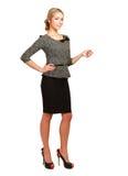 Donna di affari sorridente che indica su, isolato sopra immagini stock libere da diritti