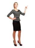 Donna di affari sorridente che indica su, isolato sopra immagini stock