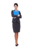 Donna di affari sorridente con il blocchetto per appunti Immagine Stock