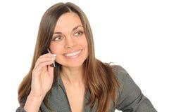 Donna di affari sul sorridere del telefono immagine stock libera da diritti