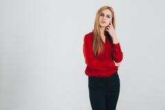 Donna di affari in una blusa rossa Fotografia Stock