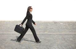 Donna di affari in una fretta Immagini Stock