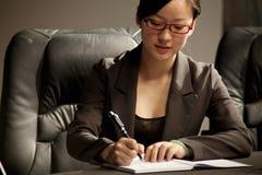 Donna di affari in una riunione immagine stock libera da diritti