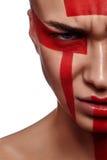Donna di bellezza con trucco rosso futuristico tribale Fotografia Stock Libera da Diritti