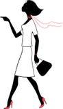 Donna di bellezza della siluetta con il sacchetto Fotografie Stock Libere da Diritti