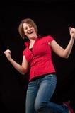 Donna di conquista felice di successo che celebra ballando. Bello yo Fotografia Stock Libera da Diritti