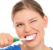 Donna di cure odontoiatriche Immagine Stock