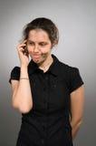Donna di dubbio con il mobile Fotografia Stock Libera da Diritti