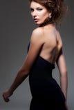 Donna di fascino in vestito da sera Fotografie Stock