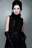 Donna di fascino in vestito ed in guanti neri Fotografia Stock Libera da Diritti