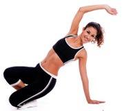 Donna di forma fisica che allunga la sua mano Immagine Stock Libera da Diritti