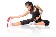 Donna di forma fisica che fa allungamento Fotografia Stock
