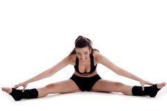 Donna di forma fisica che fa esercitazione streching immagini stock