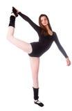 Donna di forma fisica che fa esercizio dell'equilibrio Immagine Stock