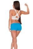 Donna di forma fisica che sta contro il fondo bianco isolato immagini stock