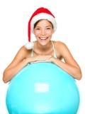 Donna di forma fisica di natale in cappello della Santa Fotografie Stock Libere da Diritti