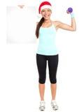 Donna di forma fisica di natale che mostra segno Immagini Stock