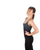 Donna di forma fisica in vestiti neri di sport isolati su bianco Fotografia Stock