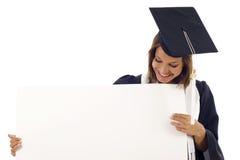 Donna di graduazione con una bandiera Immagine Stock Libera da Diritti