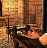 Donna di inquisizione su una cremagliera d'allungamento Immagini Stock Libere da Diritti