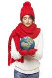 Donna di inverno con il globo Fotografie Stock Libere da Diritti