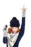 Donna di inverno con lo smartphone che indica su Immagine Stock Libera da Diritti