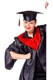 Donna di laurea felice che tiene una visualizzazione per testo Immagini Stock