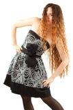Donna di modello sexy con i capelli lunghi ricci Fotografie Stock