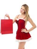 Donna di natale che tiene un sacchetto di acquisto Immagini Stock