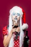 Donna di Natale con vino Immagine Stock