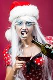 Donna di Natale con vino Immagini Stock