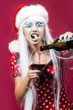 Donna di Natale con vino Fotografia Stock Libera da Diritti