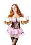 Donna di Oktoberfest che tiene sei tazze di birra Fotografie Stock Libere da Diritti