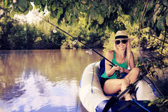 Donna di pesca immagine stock libera da diritti