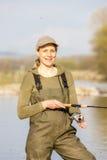 Donna di pesca Immagine Stock