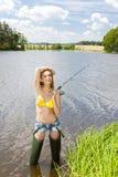 Donna di pesca Fotografie Stock