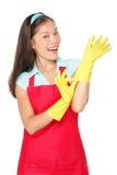 Donna di pulizia con i guanti di gomma Immagini Stock