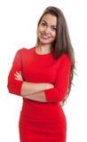 Donna di risata con le armi attraversate in un vestito rosso Fotografia Stock Libera da Diritti