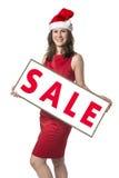 Donna di Santa Claus con il bordo di vendita Immagini Stock Libere da Diritti