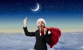 Donna di Santa con la borsa rossa Immagine Stock
