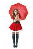 Donna di Santa nell'ambito del bacio di salto dell'aria dell'ombrello alla macchina fotografica Immagine Stock