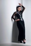 Donna di sensualità in vestito nero Immagini Stock Libere da Diritti