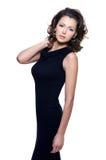 Donna di sensualità in vestito nero Immagini Stock
