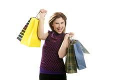 Donna di Shopaholic con i sacchetti variopinti sopra bianco Fotografia Stock