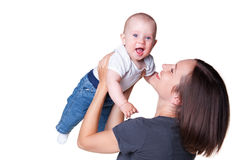 Donna di smiley che tiene bambino emozionante Immagine Stock
