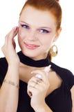 Donna di Smilling con la crema di fondamento Immagine Stock Libera da Diritti