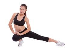 Donna di sport che allunga esercizio Fotografia Stock Libera da Diritti