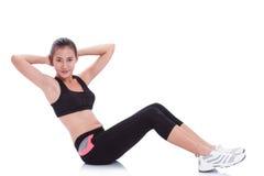 Donna di sport che allunga esercizio Immagini Stock Libere da Diritti