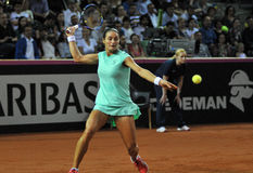Donna di tennis nell'azione Immagine Stock